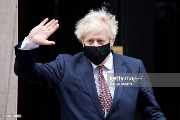 Britain's Prime Minister Boris Johnson, wearing a face covering due to the COVID-19 pandemic, leaves 10 Downing Street in central London on November...