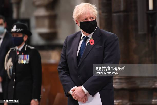 Britain's Prime Minister Boris Johnson wearing a face mask participates in a service to commemorate the centenary of the burial of the Unknown...
