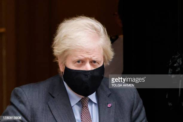 Britain's Prime Minister Boris Johnson, wearing a face mask or covering due to the COVID-19 pandemic, leaves 10 Downing Street in central London on...
