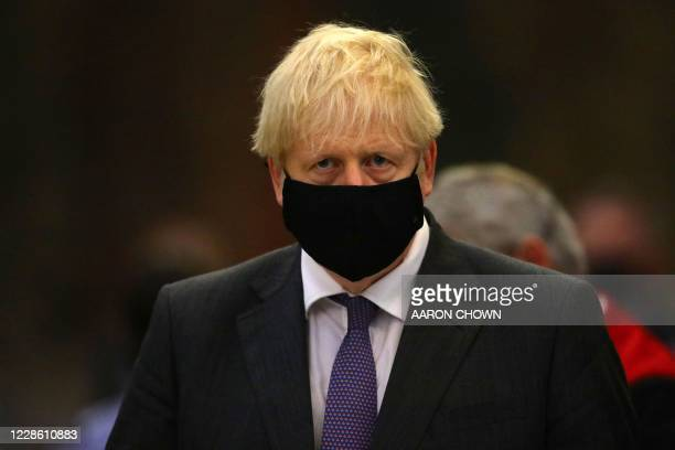 Britain's Prime Minister Boris Johnson wearing a protective face covering attends a service marking the 80th anniversary of the Battle of Britain at...