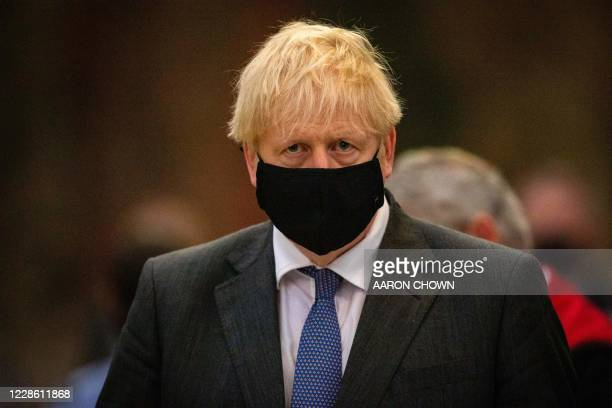 Britain's Prime Minister Boris Johnson wearing a protective face covering, attends a service marking the 80th anniversary of the Battle of Britain at...