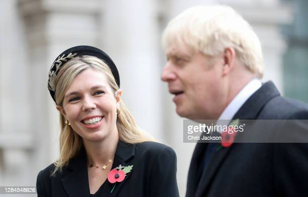 Britain's Prime Minister Boris Johnson with partner Carrie Symonds, meet veterans during the National Service of Remembrance at The Cenotaph on...