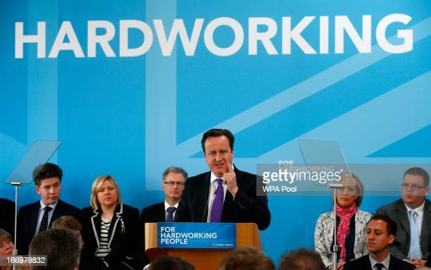 Britain's Prime Minister David Cameron addresses Conservative Party supporters at the Amberside Sports Club in Nuneaton on April 19 2013 in Nuneaton...