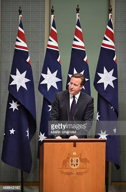 Britain's Prime Minister David Cameron addresses the House of Representatives at Parliament House in Canberra on November 14 2014 Cameron is in...