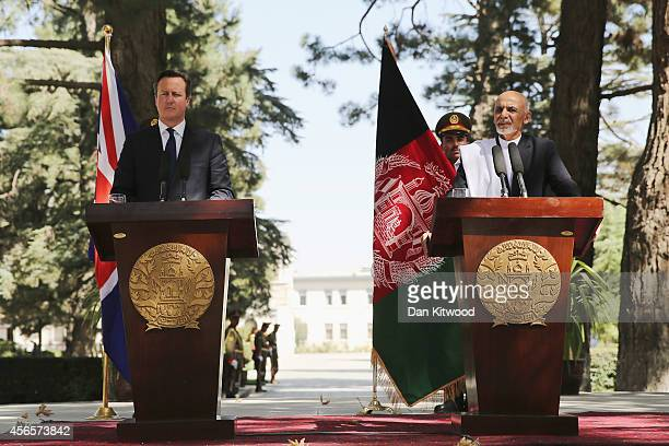 Britain's Prime Minister David Cameron and Afghan President Ashraf Ghani hold a press conference on October 3, 2014 in Kabul, Afghanistan. David...