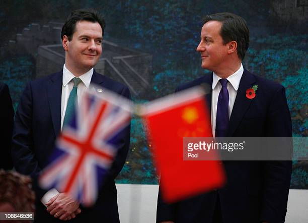Britain's Prime Minister David Cameron and Chancellor of the Exchequer George Osborne attend a signing ceremony with China's Premier Wen Jiabao at...