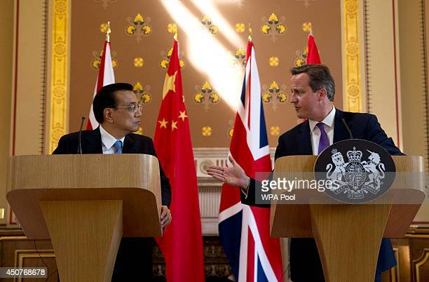 Britain's Prime Minister David Cameron and Chinese Premier Li Keqiang attend a joint press conference at the Foreign Office on June 17 2014 in London...