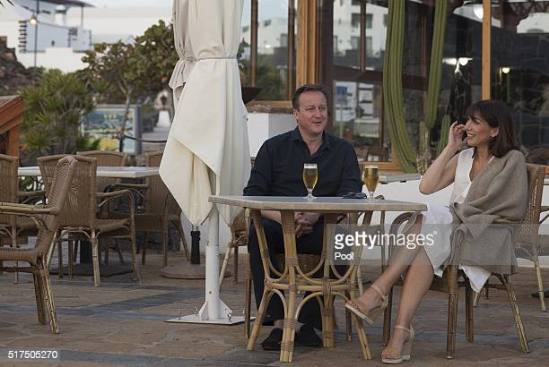Britain's Prime Minister David Cameron and his wife Samantha pose for a photograph during their holiday on March 25, 2016 in Playa Blanca, Lanzarote,...