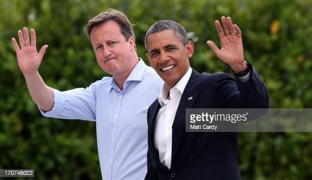 Britain's Prime Minister David Cameron and US President Barack Obama wave as they arrive at the G8 venue of Lough Erne on June 17 2013 in Enniskillen...
