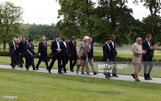 Britain's Prime Minister David Cameron and US President Barack Obama lead the lunch guests into the hotel at the G8 venue of Lough Erne on June 18...