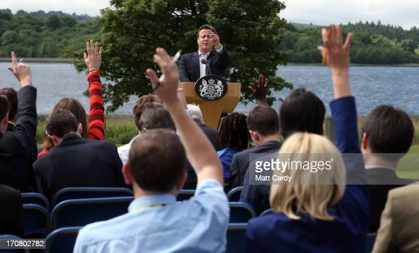 Britain's Prime Minister David Cameron answers questions at a concluding press conference at the G8 venue of Lough Erne on June 18 2013 in...