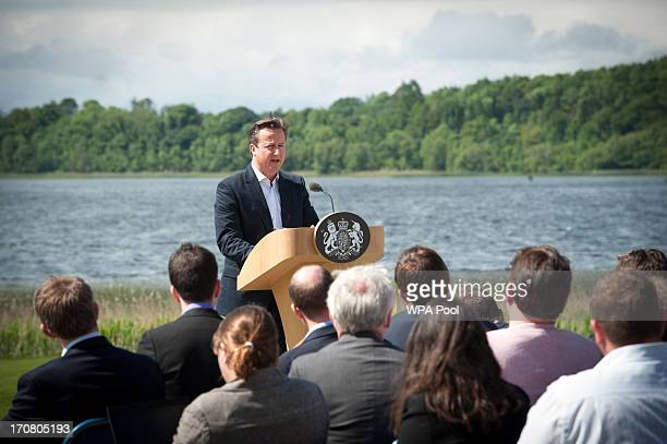 Britain's Prime Minister David Cameron answers questions from the media at a concluding press conference at the G8 venue of Lough Erne on June 18...
