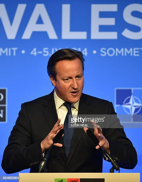 Britain's Prime Minister David Cameron answers questions from the media at a press conference on the second day of the NATO 2014 Summit at the Celtic...