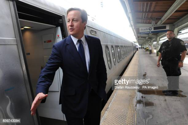 Britain's Prime Minister David Cameron boards the Acela Express from Wasington DC Washington to New York's Penn Station as part of his two day visit...