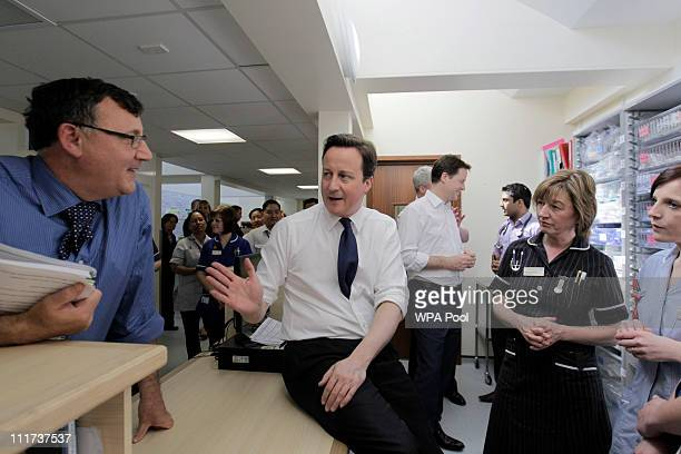 Britain's Prime Minister David Cameron center gestures as he talks to hospital staff during a visit to Frimley Park hospital on April 6 2011 in...