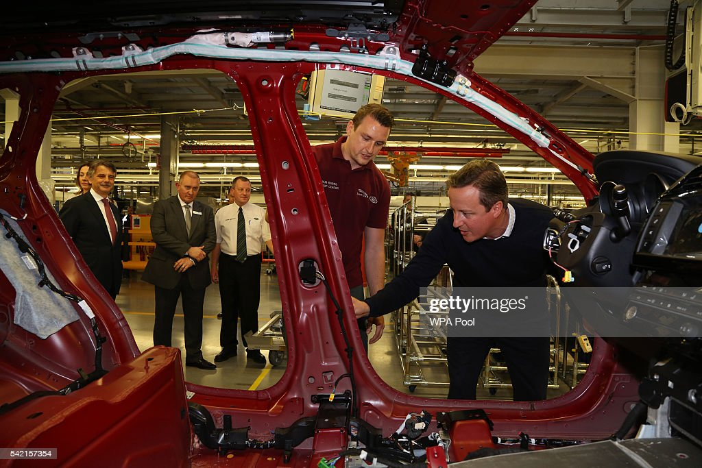 Britain's Prime Minister David Cameron fits a safety panel to a Jaguar XF at the Jaguar Land Rover factory on June 22, 2016 in Solihull, England. The final day of campaigning continues across the UK as the country prepares to go to the polls tomorrow to decide whether Britain should remain or leave the European Union.