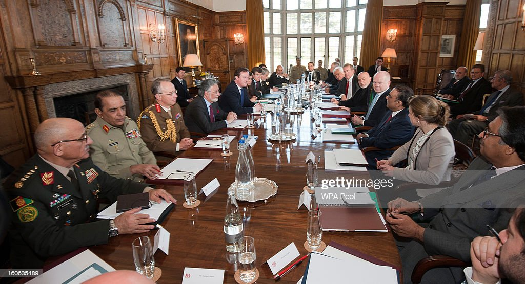 Britain's Prime Minister David Cameron (5th-L), Foreign Secretary William Hague (5th-R), Afghan President Hamid Karzai (6th-R) and Pakistani President Asif Ali Zardari (4th-R) speak to the media at the Prime Minister's official country residence, near Aylesbury in Buckinghamshire on February 4, 2013 in Chequers, England. The three leaders started these trilateral talks last year and are due now to focus on cross border security and methods to engage the Taliban in effective peace talks.