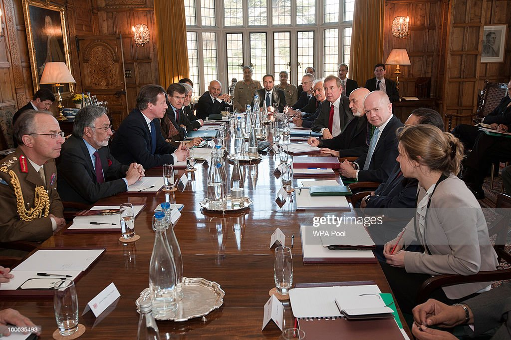 Britain's Prime Minister David Cameron (3rd-L), Foreign Secretary William Hague (3rd-R), Afghan President Hamid Karzai (4th-R) and Pakistani President Asif Ali Zardari (2nd-R) speak to the media at the Prime Minister's official country residence, near Aylesbury in Buckinghamshire on February 4, 2013 in Chequers, England. The three leaders started these trilateral talks last year and are due now to focus on cross border security and methods to engage the Taliban in effective peace talks.
