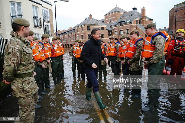 Britain's Prime Minister David Cameron greets British soldiers working on flood relief after the river Ouse burst its banks in York city centre...