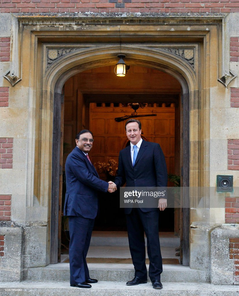 Britain's Prime Minister David Cameron, greets Pakistan's President Asif Ali Zardari as they meet on August 5, 2010 at Chequers near Princes Risborough in England. President Zardari has come under fire for his diplomatic visit to the UK whilst over 1,100 people have been killed by devastating floods in his country.