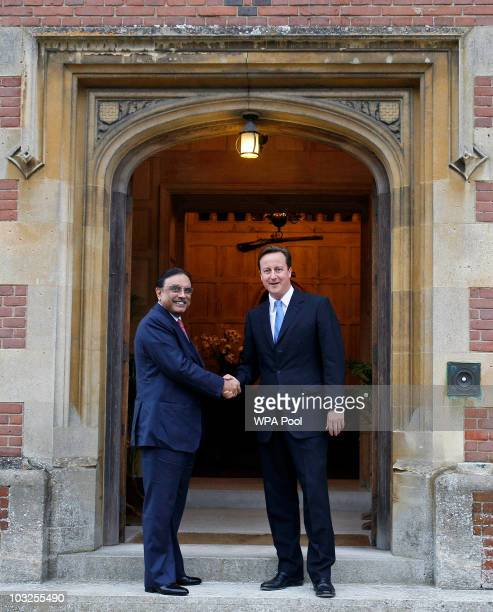 Britain's Prime Minister David Cameron, greets Pakistan's President Asif Ali Zardari as they meet on August 5, 2010 at Chequers near Princes...