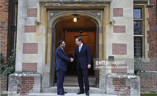 Britain's Prime Minister David Cameron greets Pakistan's President Asif Ali Zardari at Chequers near Princes Risborough on August 5 2010 British...