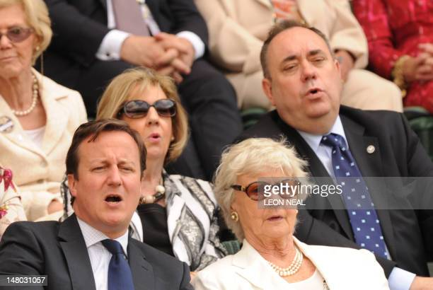 Britain's Prime Minister David Cameron his mother Mary First Minister of Scotland Alex Salmond and his wife Moira react to the action from the Royal...