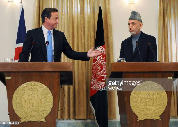 Britain's Prime Minister David Cameron holds a joint press conference with President Hamid Karzai, at the Presidential Palace, during his first visit...