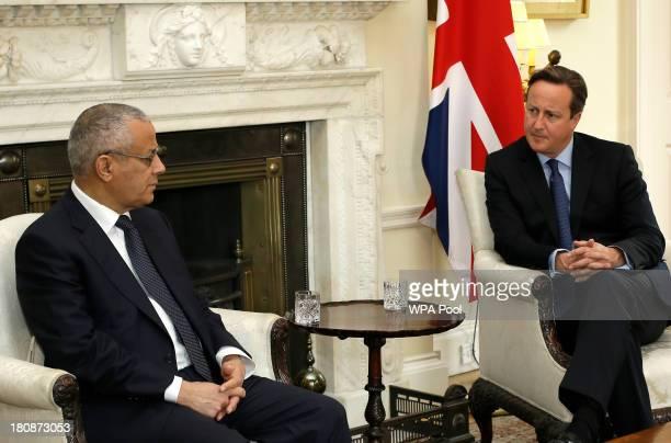Britain's Prime Minister David Cameron listens as he speaks to Libya's Prime Minister Ali Zeidan inside 10 Downing Street on September 17, 2013 in...