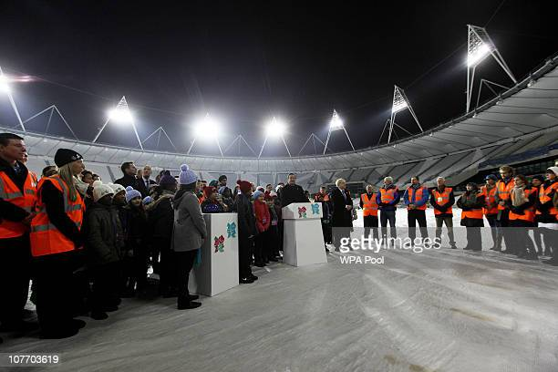 Britain's Prime Minister David Cameron makes a speech beside London Mayor Boris Johnson, after turning on the floodlights during an official...