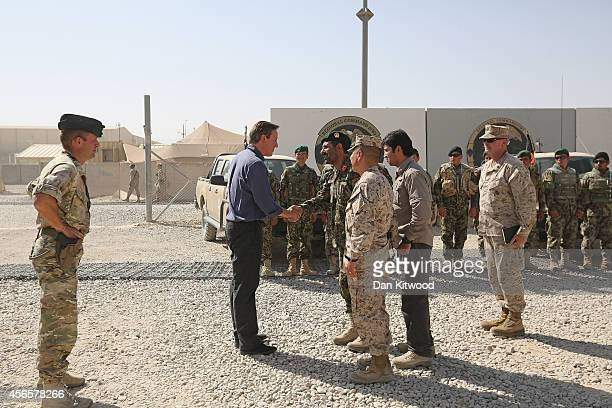 Britain's Prime Minister David Cameron Meets General Malouk head of 215 corp in helmand province and members of the Afghan army on October 3 2014 in...