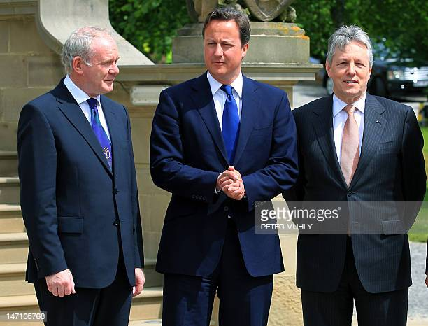 Britain's Prime Minister David Cameron meets Northern Ireland's First Minister Peter Robinson and Deputy First Minister Martin McGuinness as he...