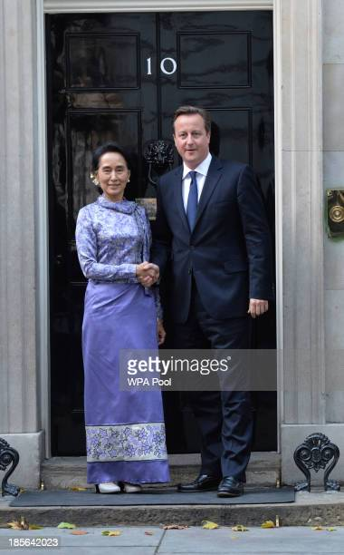 Britain's Prime Minister David Cameron meets with Myanmar's opposition leader Aung San Suu Kyi in Downing Street on October 23 2013 in London England...