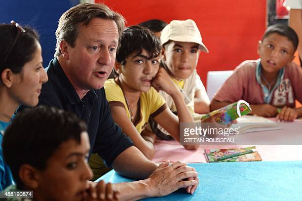 Britain's Prime Minister David Cameron meets with refugee children at the UNICEF Makani Centre at the Za'atri refugee camp near Amman Jordan on...