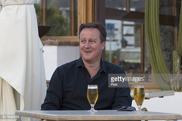 Britain's Prime Minister David Cameron poses for a photograph during their holiday on March 25, 2016 in Playa Blanca, Lanzarote, Spain.