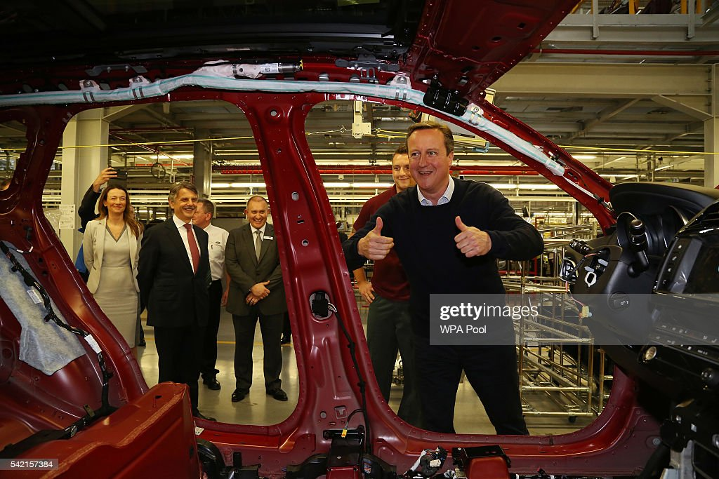 Britain's Prime Minister David Cameron reacts after fitting a safety panel to a Jaguar XF at the Jaguar Land Rover factory on June 22, 2016 in Solihull, England. The final day of campaigning continues across the UK as the country prepares to go to the polls tomorrow to decide whether Britain should remain or leave the European Union.