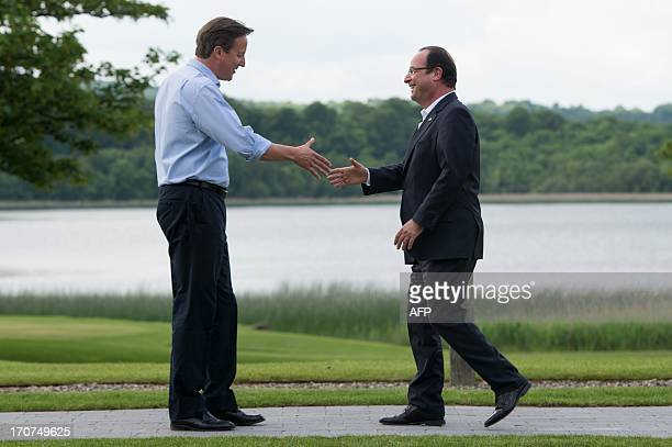 Britain's Prime Minister David Cameron shakes hands with France's President Francois Hollande during the official welcome as world leaders arrive for...
