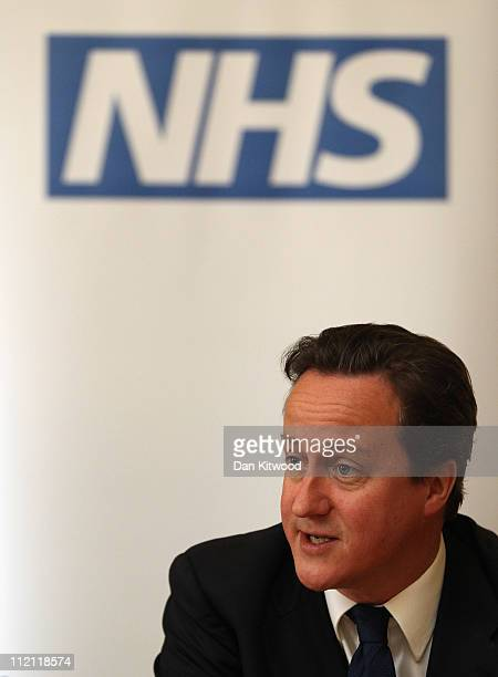 Britain's Prime Minister David Cameron speaks during a meeting with healthcare representatives at 10 Downing Street on April 13 2011 in London...