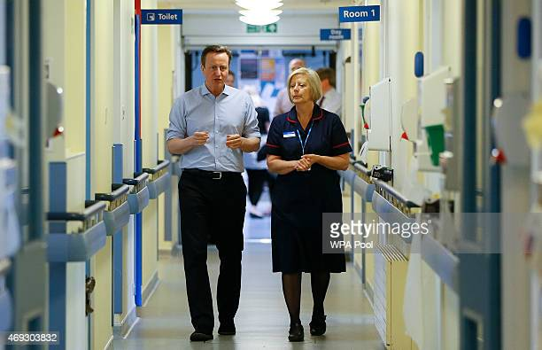Britain's Prime Minister David Cameron speaks to matron Sandra Allen during a visit to Whitney Community Hospital on April 11 2015 in Whitney England...