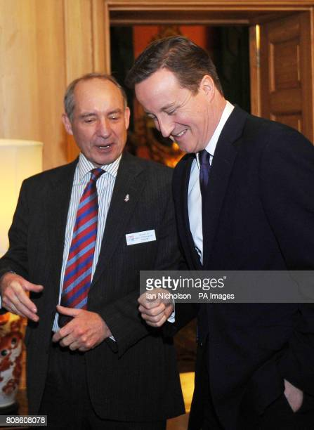Britain's Prime Minister David Cameron speaks to SSAFA Chairman General Sir Kevin O'Donoghue at a reception in Downing Street celebrating the 125th...