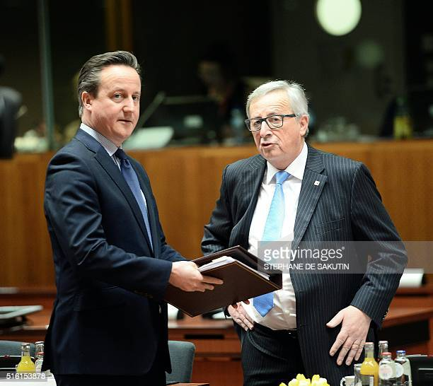 Britain's Prime Minister David Cameron speaks with European Commission President JeanClaude Juncker during an EU summit meeting on March 17 2016 at...
