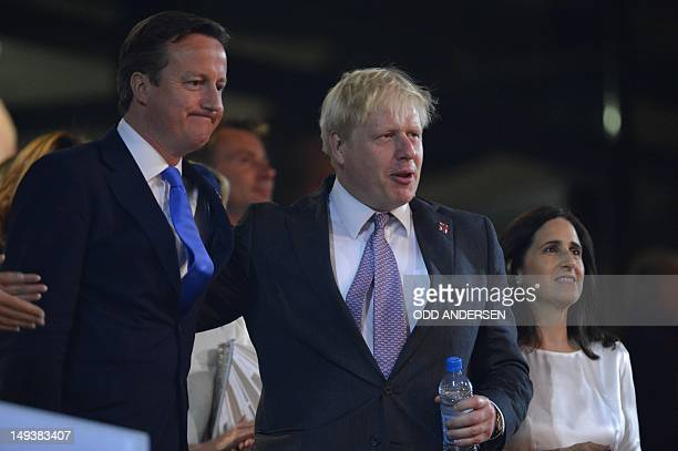 Britain's Prime Minister David Cameron stands next to London's Mayor Boris Johnson and Marina Wheeler during the opening ceremony of the London 2012...
