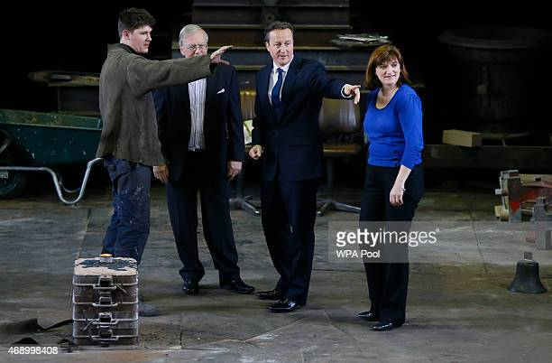 Britain's Prime Minister David Cameron stands with Foundry Chairman Andrew Wilby apprentice Anthony Stone and local MP Nicky Morgan as they watch a...