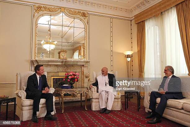 Britain's Prime Minister David Cameron talks with President Ashraf Ghani and Chief Executive Officer Abdullah Abdullah during a trilateral meeting at...