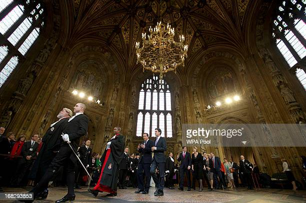 Britain's Prime Minister David Cameron walks with the Leader of the Opposition Ed Milliband and other lawmakers from the House of Commons through the...