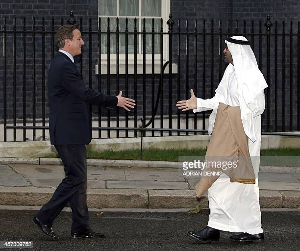Britain's Prime Minister David Cameron welcomes Crown Prince of Abu Dhabi Sheikh Mohammed bin Zayed alNahyan upon arrival for a meeting at No 10...