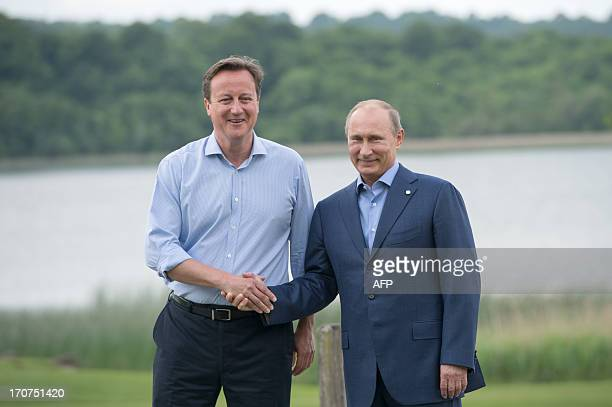 Britain's Prime Minister David Cameron welcomes Russia's President Vladimir Putin during the official arrivals for the start of the G8 Summit in at...