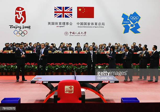 Britain's Prime Minister Gordon Brown and Chinese Premier Wen Jiabao make a speech after watching a table tennis match between Chinese and British...