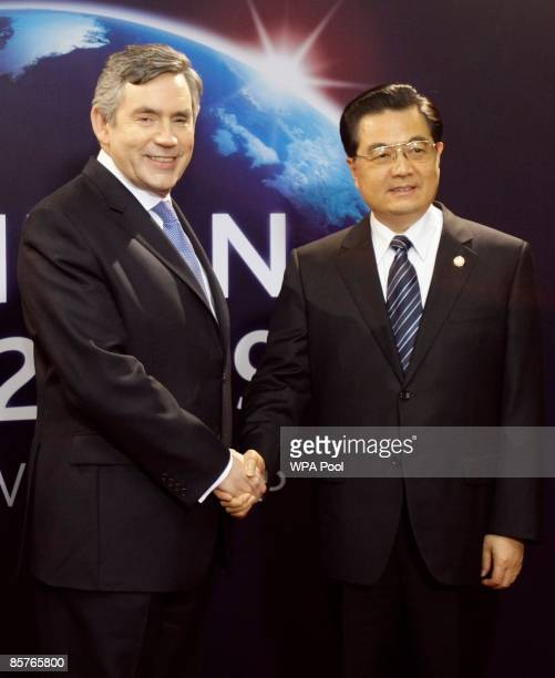 Britain's Prime Minister Gordon Brown greets China's President Hu Jintao as he arrives for the G20 summit at the ExCel centre on April 2 2009 in...