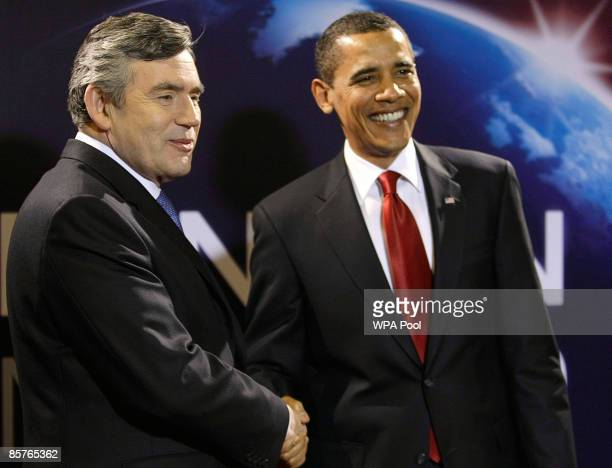 Britain's Prime Minister Gordon Brown greets US President Barack Obama as he arrives for the G20 summit at the ExCel centre on April 2 2009 in London...